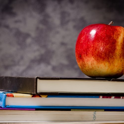 close-up-of-apple-on-top-of-books-256520